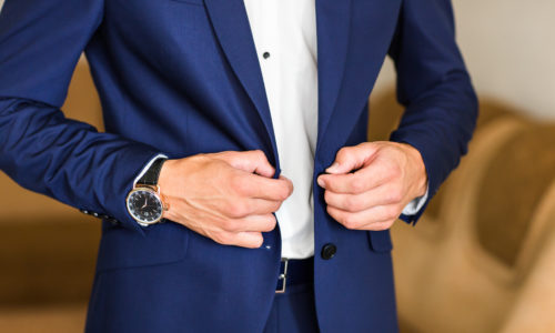 Man buttoning jacket. businessman puts on a suit