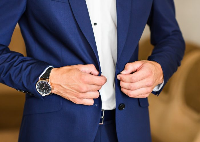Man buttoning jacket. businessman puts on a suit